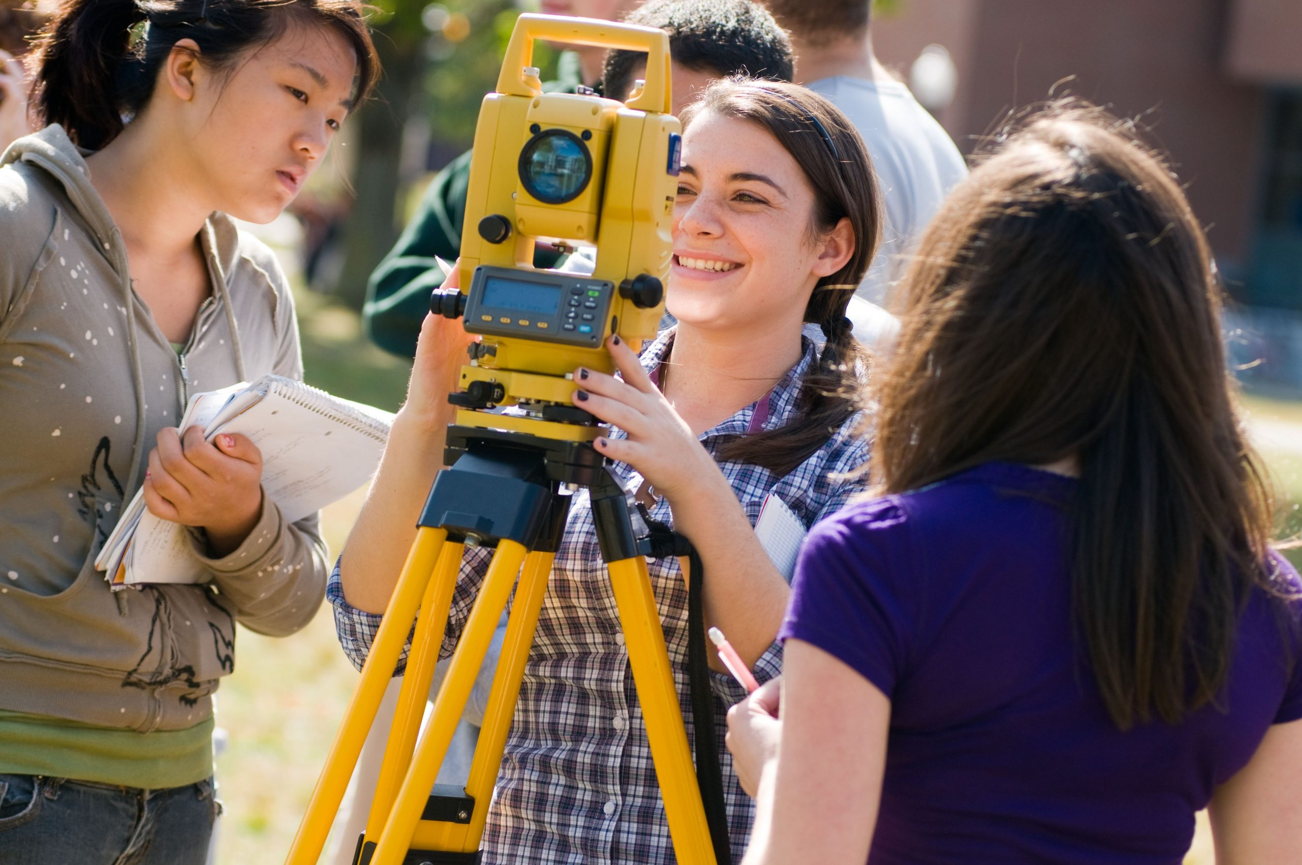 Students engaged in a Surveying class outside the Student Union Mall.